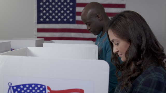 Side view black man and white woman voting in slow motion 4K