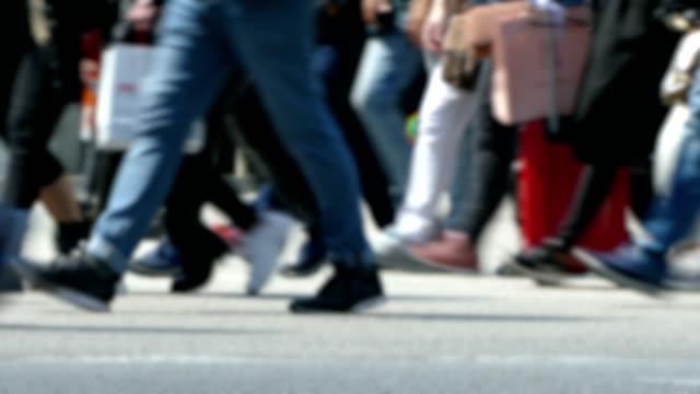 side view blurry pedestrians walking. - urban street video stock e b–roll