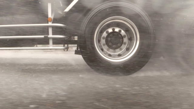 side view from car / rainstorm / slow motion /driving studio process plate - truck tire video stock e b–roll