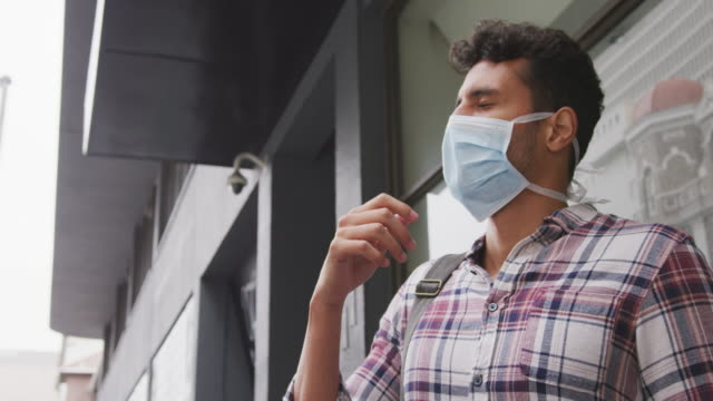 Side view of Caucasian man wearing a corovirus covid19 mask