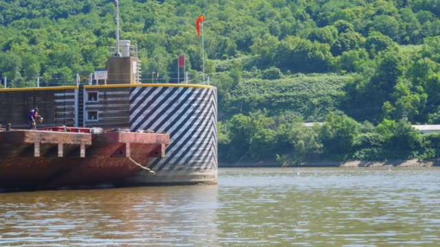 Side View of Coal Barge Exiting Lock and Dam on Ohio River video