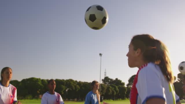 Side view of female soccer team training 4k