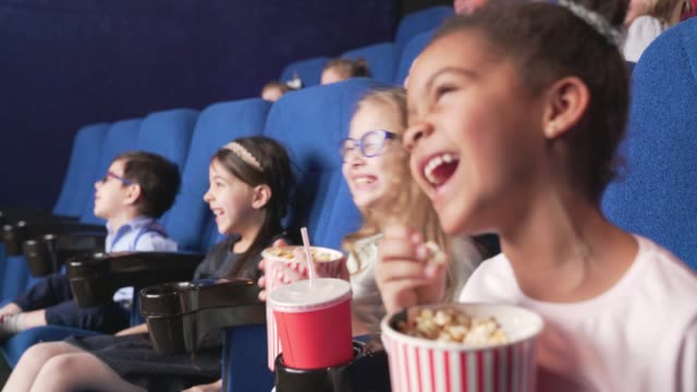 Side view of happy children enjoying funny moments of comedy