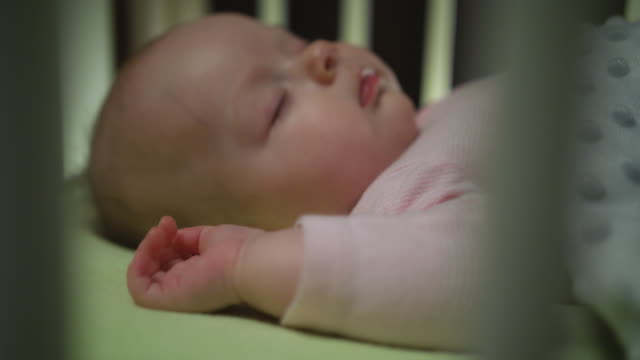 Side View of Sleeping Newborn Baby Dolly Shot Close Up video