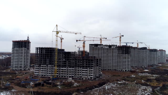 A side view on several unfinished apartment buildings. video