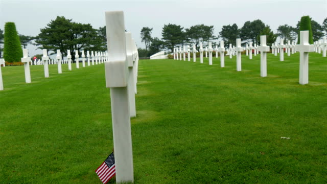 Side views of the white cross in the Normandy cemetery video