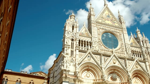 Siena Cathedral, Tuscany, Italy Wide shot of the Siena Cathedral dating from 1196 and Piazza del Duomo in Siena, Tuscany, Italy, a UNESCO World Heritage Site renaissance architecture stock videos & royalty-free footage