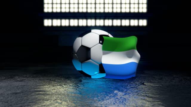 sierra leone flag flies around a soccer ball - sierra leone video stock e b–roll