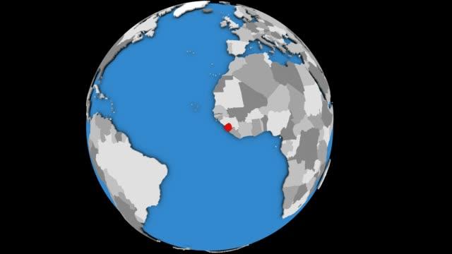 sierra leone on political globe - sierra leone video stock e b–roll
