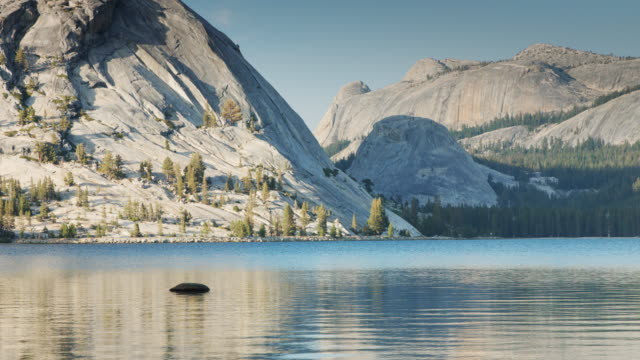 Sierra Nevada Granite Slopes Leading Down to Tranquil Tenaya Lake video