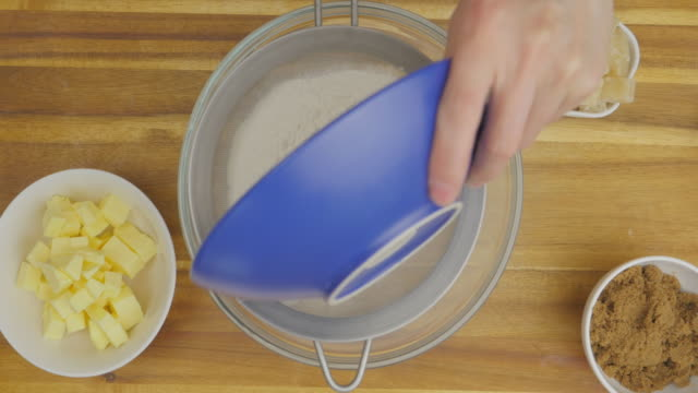 sieve flour into mixing bowl for making a cake top view of sieve flour into mixing bowl for making a cake mixing bowl stock videos & royalty-free footage