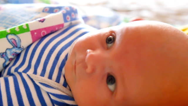 Sight of a newborn baby child's eyes macro baby look close up shot video