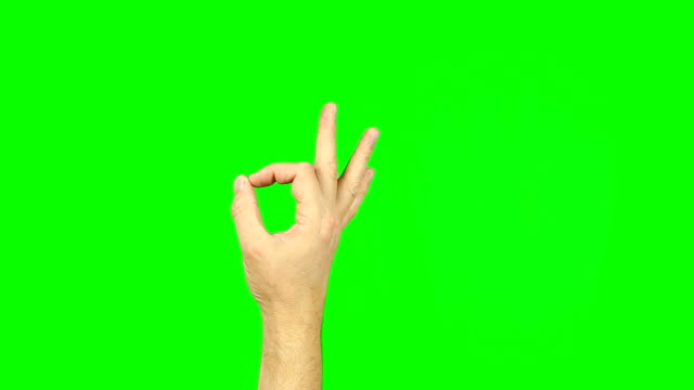 ok sign fingers gesture on green screen. simbol of approval, agreement, or that all is well. thumb and index fingers into a circle sign. footage contains solid green instead alpha channel easy keying. - znak ok filmów i materiałów b-roll