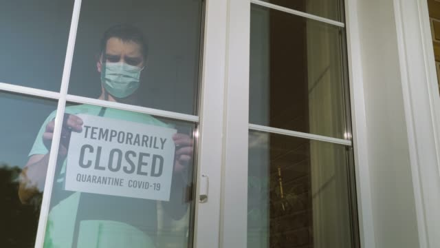 TEMPORALLY CLOSED sign glued to the front door video