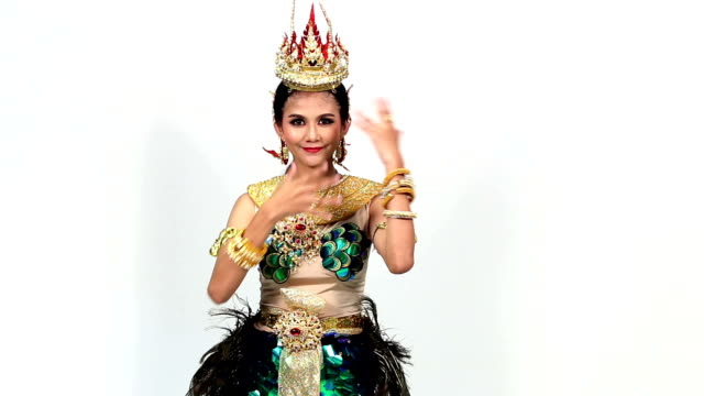 Sign Language by Asian woman in National Contest Costume over Gray Background, Mean