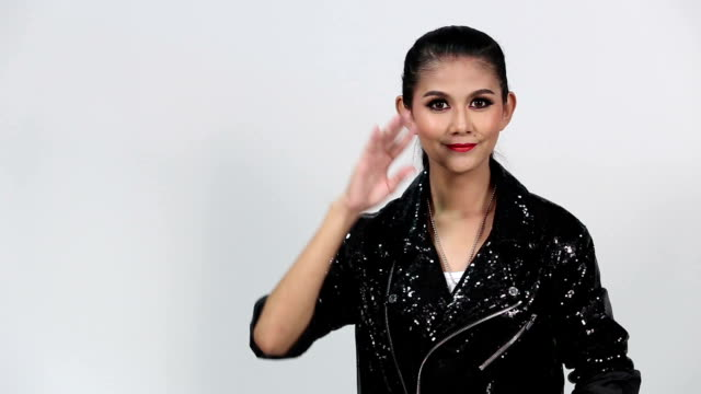 Sign Language by Asian woman in Suit Jacket over Gray Background, Mean 'We Are All Connected' video