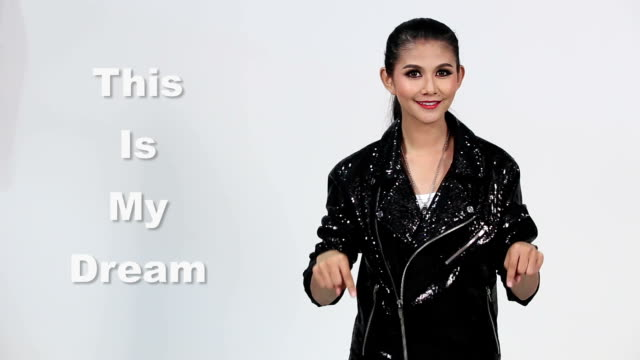 Sign Language by Asian woman in Suit Jacket over Gray Background, Mean 'This is my Dream' video