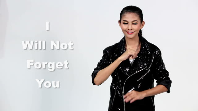 Sign Language by Asian woman in Suit Jacket over Gray Background, Mean 'I Miss You' video