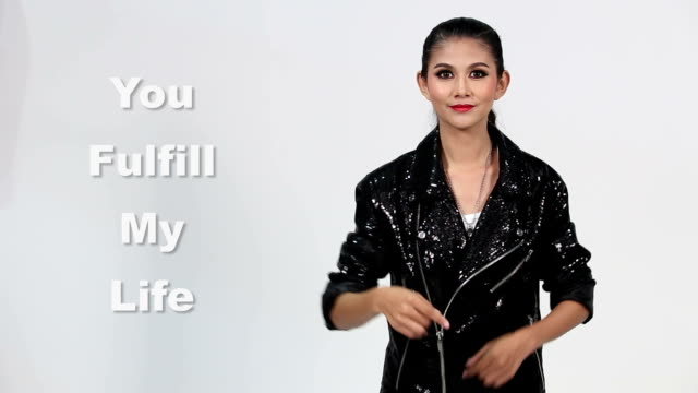 Sign Language by Asian woman in Suit Jacket over Gray Background, Mean 'You Fulfill my Life' video