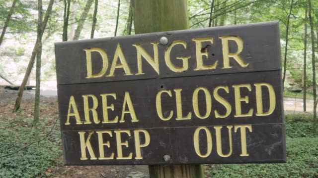 Sign on a Forest Trail Reads - Danger Area Closed Keep Out video