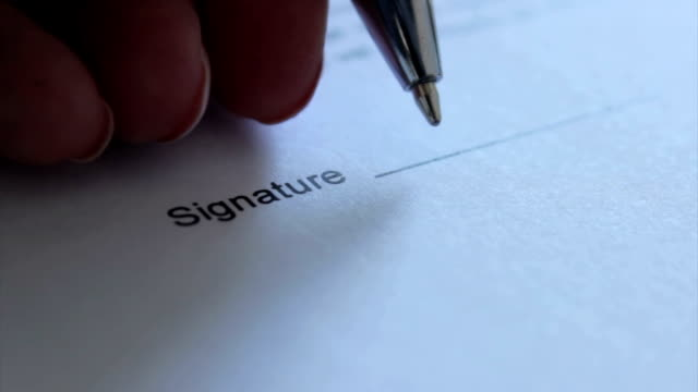 signature with left hand - firma video stock e b–roll