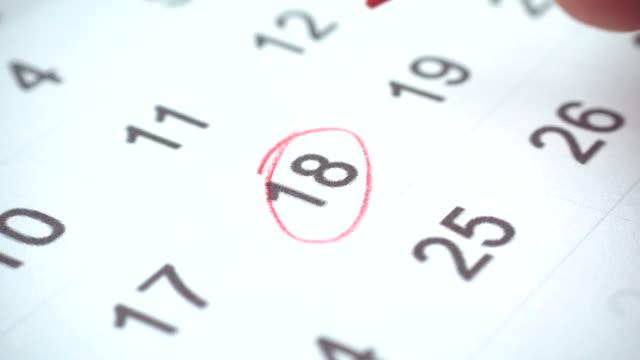 signing a day on a calendar, 4k - data scritta video stock e b–roll