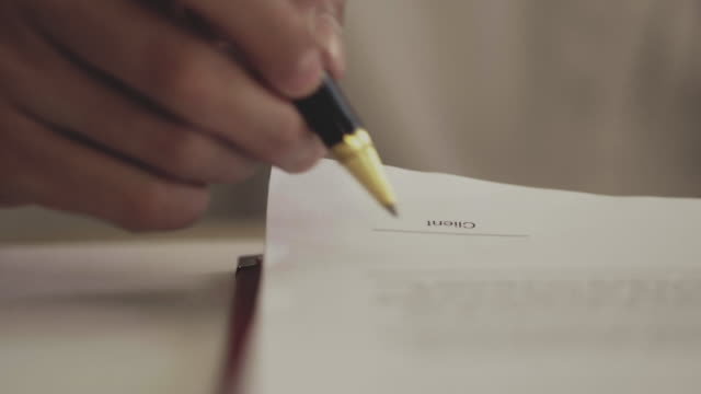signing contracts - firma video stock e b–roll