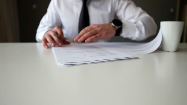 signing official document - contratto video stock e b–roll