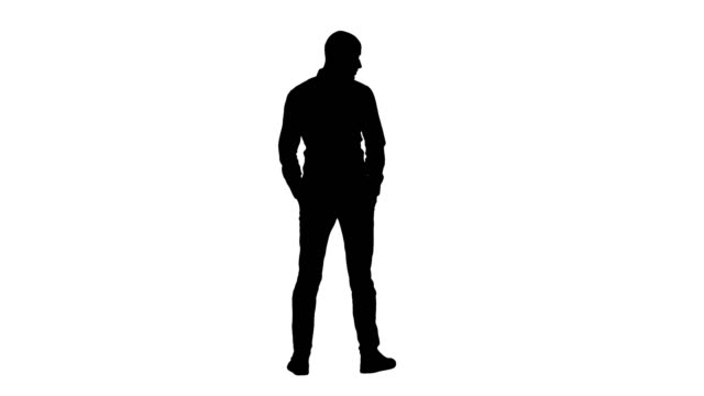 Silhouette Arab in casual looking around with hands in pockets