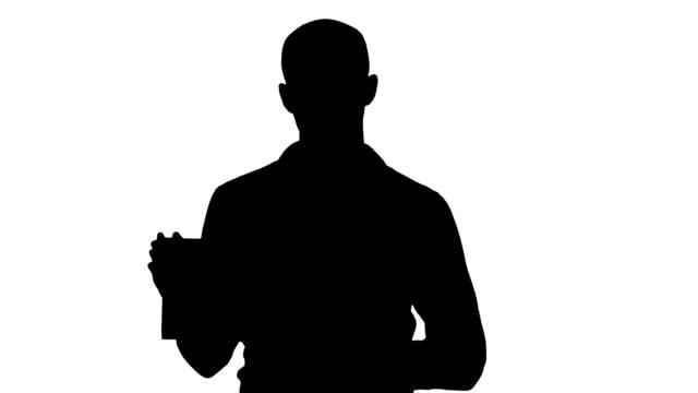 Silhouette Arab man showing blank tablet screen