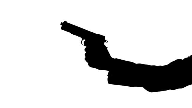 sylwetka grupy z pistoletu, mając w dół zabytków i przeszywający - szpieg filmów i materiałów b-roll