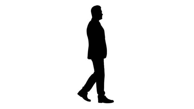 Silhouette Businessman goes forward Full length shot. Side view. Silhouette Businessman goes forward. Professional shot in 4K resolution. 014. You can use it e.g. in your commercial video, business, presentation, broadcast silhouette stock videos & royalty-free footage