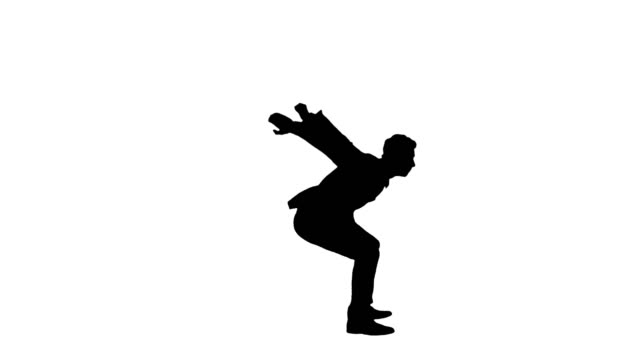 Silhouette Businessman makes a back flip and shows cool gesture to camera after Wide shot. Silhouette Businessman makes a back flip and shows cool gesture to camera after. Professional shot in 4K resolution. 022. You can use it e.g. in your commercial video, business, presentation, broadcast businesswear stock videos & royalty-free footage