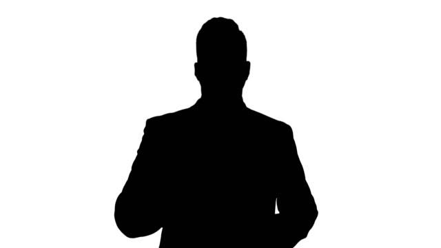 短いビジネスのヒントを与えるシルエットビジネスマンマネージャー。トレーニング - プロジェクトマネージャー点の映像素材/bロール