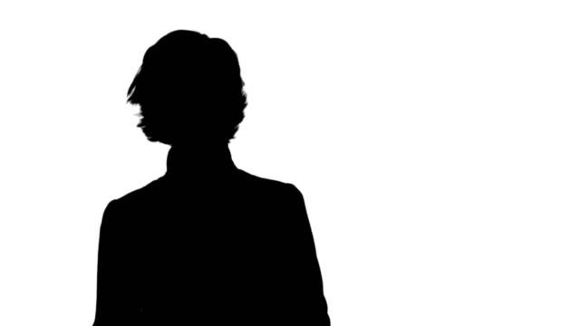 Silhouet zakenvrouw in gesprek met camera track mat video