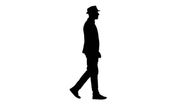 Silhouette Casual arabic man in hat walking Full length shot. Side view. Silhouette Casual arabic man in hat walking. Professional shot in 4K resolution. 011. You can use it e.g. in your commercial video, business, presentation, broadcast silhouette people stock videos & royalty-free footage
