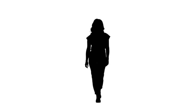 silhouette casual woman walking and smiling - in silhouette stock videos & royalty-free footage