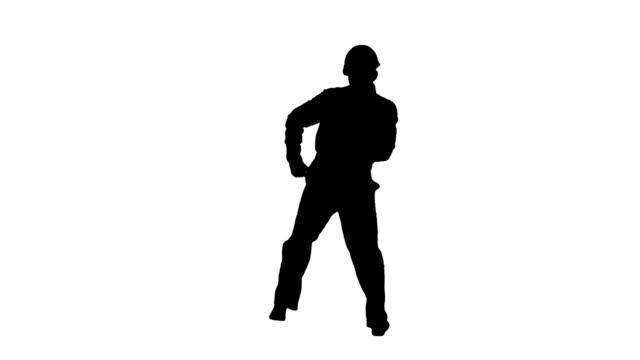 Silhouette Construction worker in helmet dancing – film
