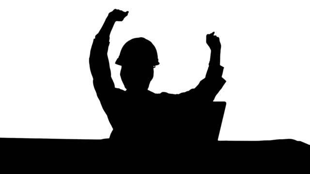 Silhouette Female chief engineer celebrate a successful finish of project, smiling video