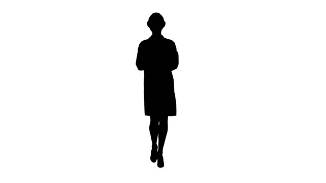Silhouette Female doctor engineer walking with digital tablet