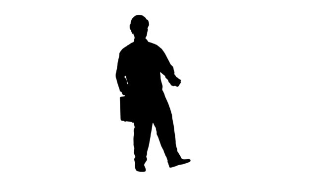 Silhouette Funky and successful engineer, manager or architect dancing and having fun track matte video
