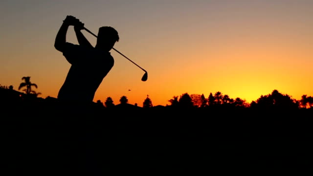 Silhouette Golfer At Sunset video