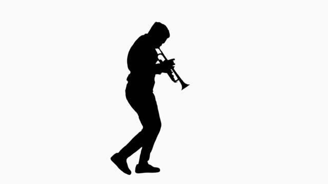 Silhouette Happy businessman in headphones listening to music