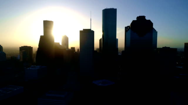 Silhouette Houston , Texas Aerial Drone View at Sunrise with sun behind Downtown Skyline Cityscape video