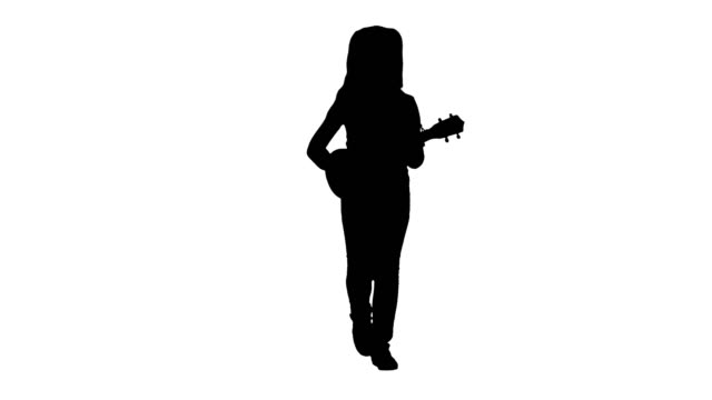 Silhouette Little girl singing and playing small guitar while walking towards camera