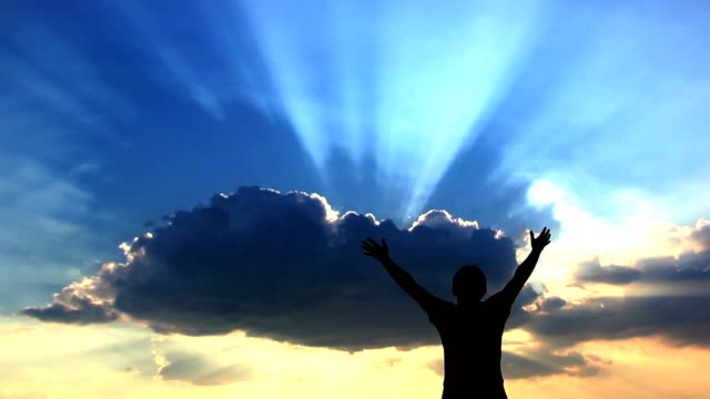 Silhouette man prays to God at dawn, man with his hands up at sunset video