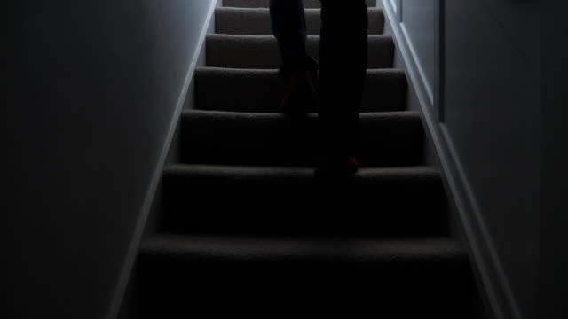 silhouette man walking upstairs at night. 1. - child abuse stock videos & royalty-free footage