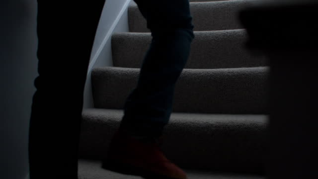 Silhouette man walking upstairs at night. 2. Dark silhouette of a man, lower body walking upstairs in a domestic house. Shot at 60 fps. SM DS. See alternative camera angle as part of a series. staircases stock videos & royalty-free footage