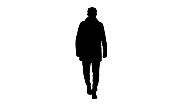Silhouette Man with dark beard in light trench coat walks video