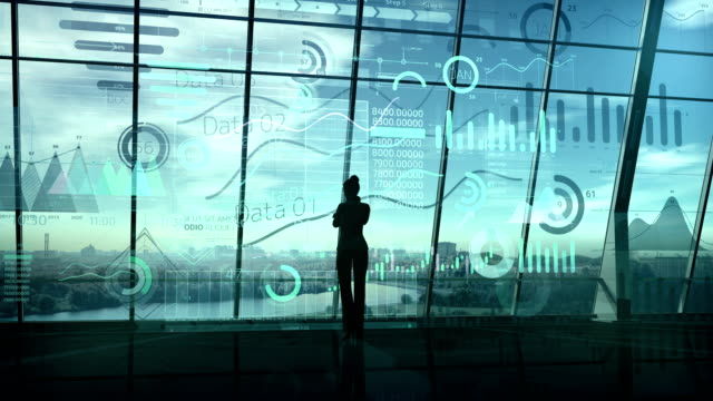 Silhouette of a business woman surrounded by an array of data.